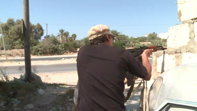 libyan rebels sunday launched a fierce battle for tripoli capturing a barracks and overrunning tajura suburb as reinforcements raced to join them for... - az zawiyah stock videos & royalty-free footage