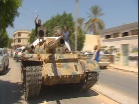 libyan rebels travel in a tank and greet people zawiya august 2011 - az zawiyah stock videos & royalty-free footage