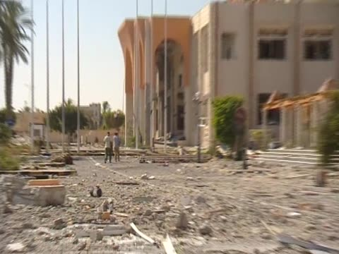 libyan rebels walk towards a destroyed building in zawiya libya august 2011 - az zawiyah stock videos & royalty-free footage