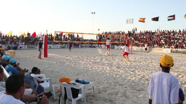 libyan volleyball players, joined by a team of amateur spanish players, took part on sunday in zouwara, about 160 kilometres west of the libyan... - dondolarsi video stock e b–roll