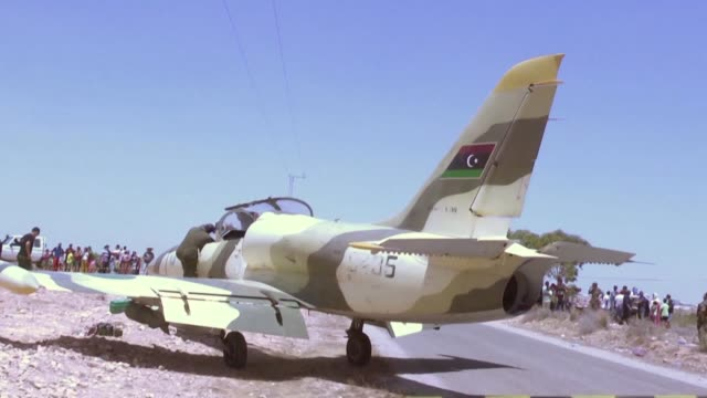 a libyan warplane of military commander khalifa haftar's forces made an emergency landing in neighbouring tunisia authorities in libya said - vox populi stock videos & royalty-free footage