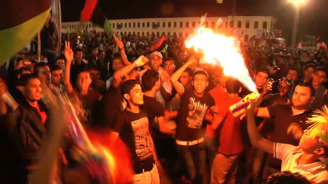 libyans have been celebrating late into the night after liberation was declared. thousands took to the streets of benghazi where the uprising began... - arab spring stock videos & royalty-free footage