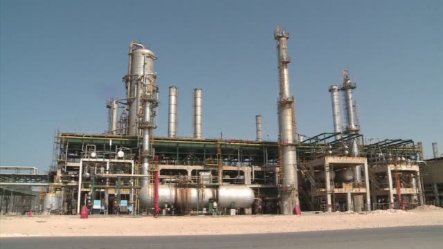 libyas economy has made a swift recovery after the 2011 conflict with oil production returning to near normal levels but insecurity is holding up... - az zawiyah stock videos & royalty-free footage