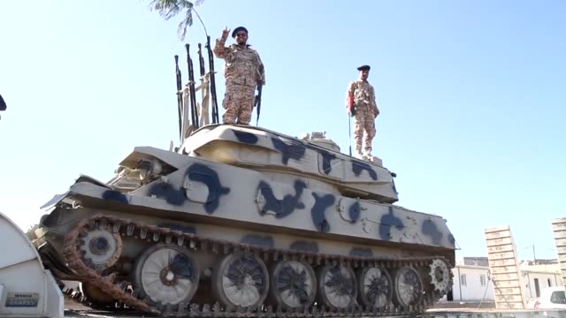 Libyas government announced this week plans to remove militias from the capital and eventually integrate them into the security forces in response to...