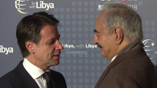 libya's key political players meet with global leaders in italy in the latest bid by major powers to kickstart a long stalled political process and... - asta oggetto creato dall'uomo video stock e b–roll