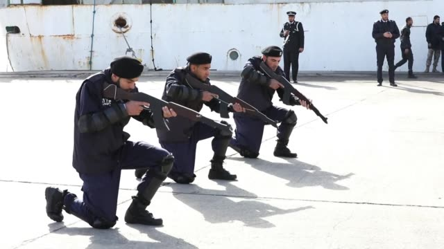 stockvideo's en b-roll-footage met libya's national unity government prime minister fayez al sarraj attends a graduation ceremony for the coastguards at the port in tripoli - prime minister