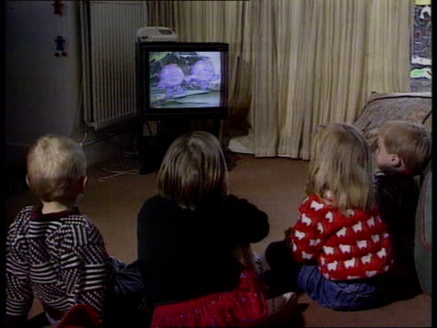 tv licence fee may be raised to fund bbc digital lib bv four young children seated on floor watching tv - fee stock videos & royalty-free footage