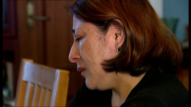 lidia guaranda crying close shot of computer screen showing received text and response from 'missing people' - missing people stock videos & royalty-free footage