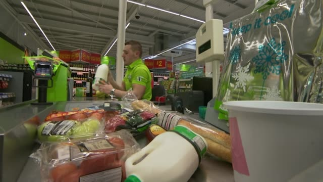 Lidl to pay workers the living wage LIB / 2432015 Leeds Products being scanned at checkout in Asda supermarket