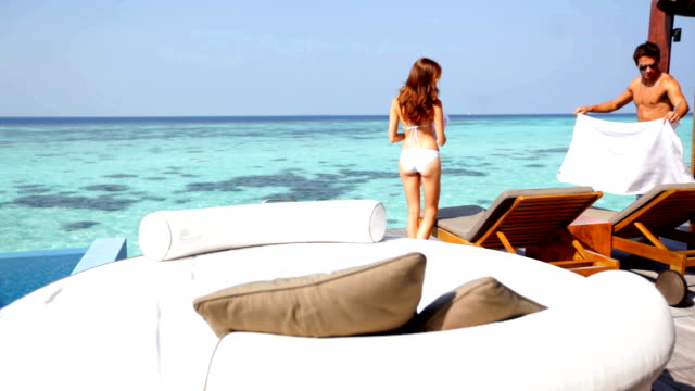 lie back and relax... - deckchair stock videos & royalty-free footage