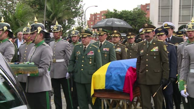 lieutenant colonel alfredo ruiz who died friday in an attack attributed to farc rebels received military honours at his funeral in bogota - military attack stock videos and b-roll footage
