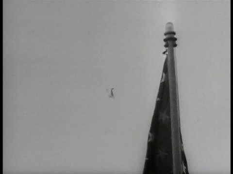 lieutenant commander j.j. hughes on uss panay deck using binoculars, pointing. japanese aircraft diving in sky. two gunners firing. uss panay taking... - binoculars stock videos & royalty-free footage