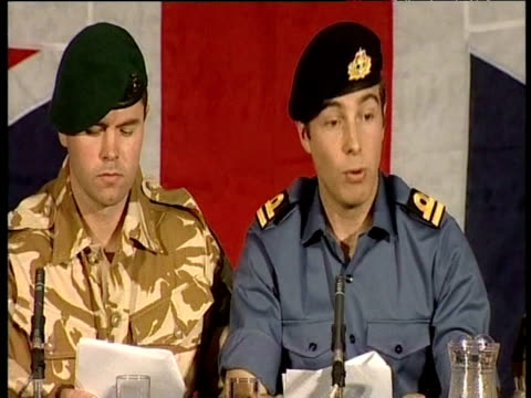 lieutenant felix carman royal navy seated with captain chris air royal marines at press conference confirming that he and his colleagues were... - 英国海兵隊点の映像素材/bロール