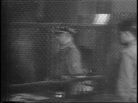 lieutenant general dietrich von choltitz exits military jeep / choltitz walking inside building / choltitz sitting at desk / pan along german... - ゲシュタポ点の映像素材/bロール