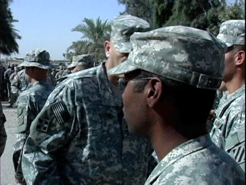 lieutenant general ray odierno shaking hands with reenlisted soldiers during 911 ceremony at camp victory / baghdad iraq / audio - campo militare video stock e b–roll