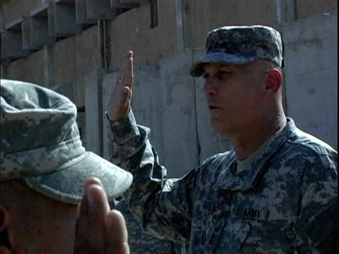 lieutenant general ray odierno swearing-in reenlisted soldiers during 9-11 ceremony at camp victory / baghdad, iraq / audio - 2007 stock videos & royalty-free footage