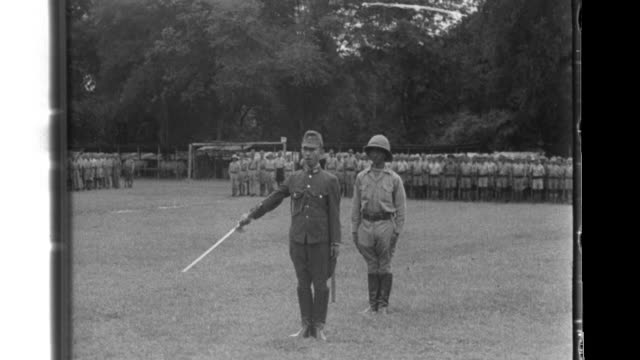 Lieutenant General Shojiro Iida Commander Iida of the 15th Army and his chief of staff LieutenantColonel Thakin Aung San inspect and review officers...