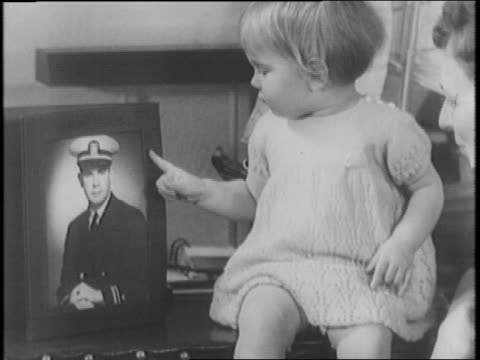 lieutenant john duncan bulkeley war hero who piloted pt boat into philippine harbor under heavy fire to sink japanese ship / wife and daughter... - 1942年点の映像素材/bロール