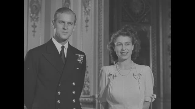 lieutenant philip mountbatten and princess elizabeth pose for photos in buckingham palace for the last time before their upcoming wedding / note... - prince philip stock videos & royalty-free footage