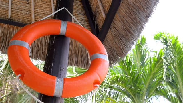 life belt hanging on wood pole - buoy stock videos and b-roll footage