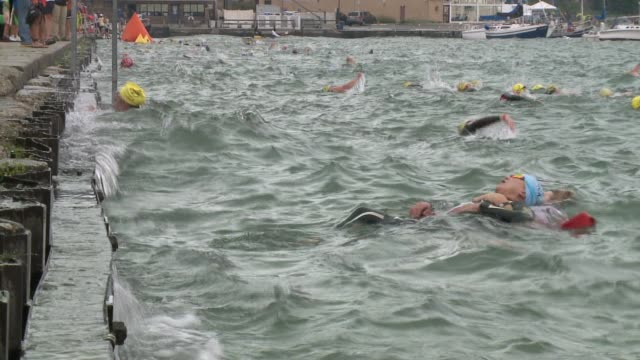 life guard pulls chicago triathlon participant out of lake michigan on august 24 2014 in chicago illinois - participant stock videos & royalty-free footage