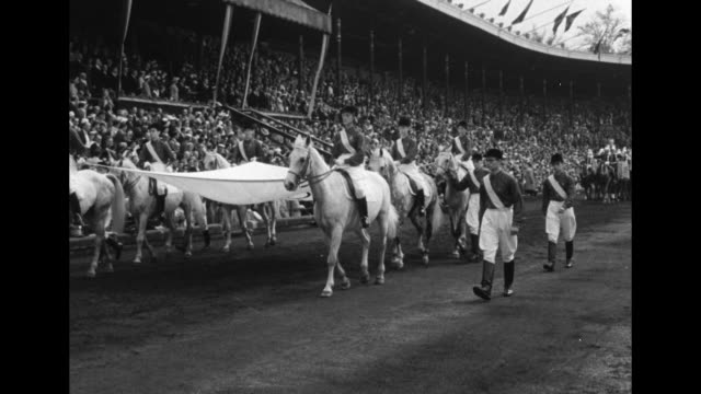 stockvideo's en b-roll-footage met life guards and carriages parade on stockholm olympic stadium grounds during opening ceremony / elizabeth ii and king gustaf vi adolf of sweden ride... - 1956