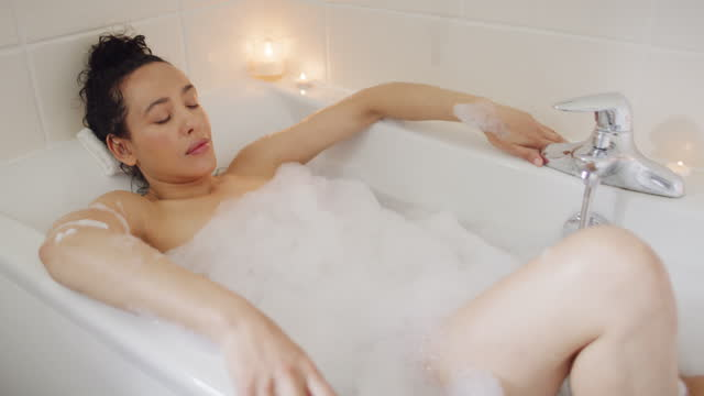life happens, a bubble bath helps - serene people stock videos & royalty-free footage