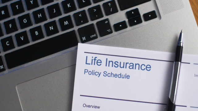 life insurance schedule with laptop computer - life insurance stock videos & royalty-free footage
