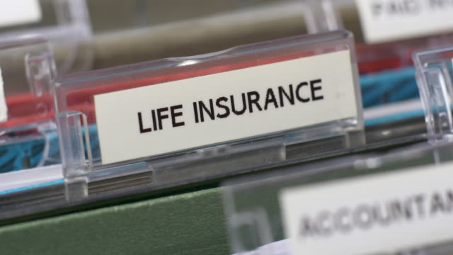 life insurance tab on file. - file stock videos & royalty-free footage