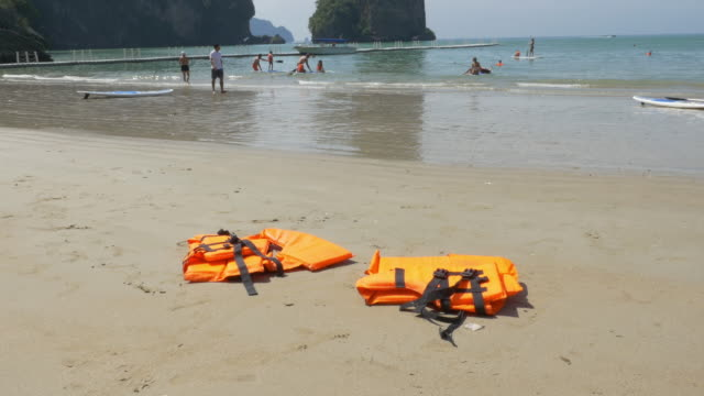 life jackets on beach.(4k) - life belt stock videos & royalty-free footage