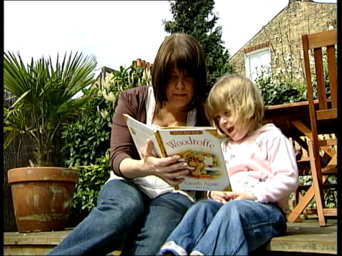 breast feeding england london clapham ext mother rachel friend reading book to young daughter rachel friend interview sot one of first things i... - breastfeeding stock videos and b-roll footage