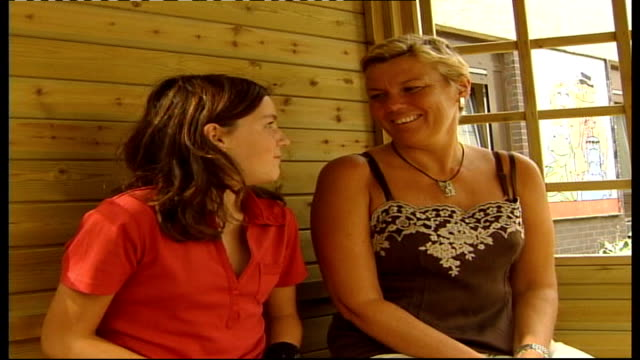 Cystic Fibrosis Ashley Parlane and mother Shona Parlane sitting in summer house talking