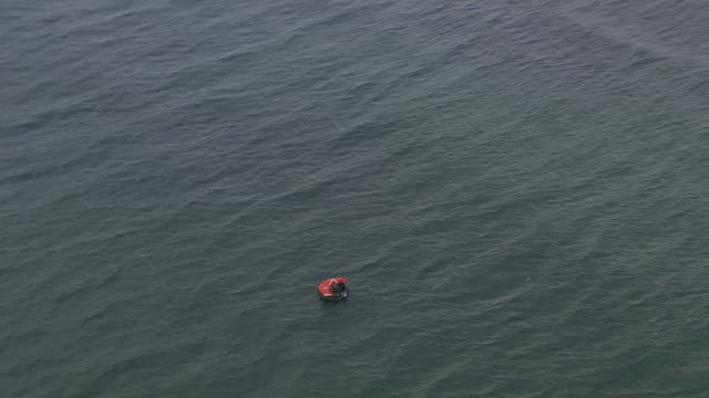 A life raft floats on the ocean.
