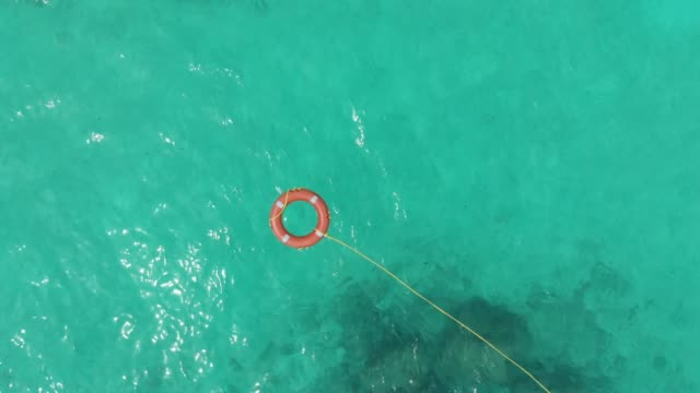 life rescue buoy in tropical water aerial - floating on water stock videos & royalty-free footage