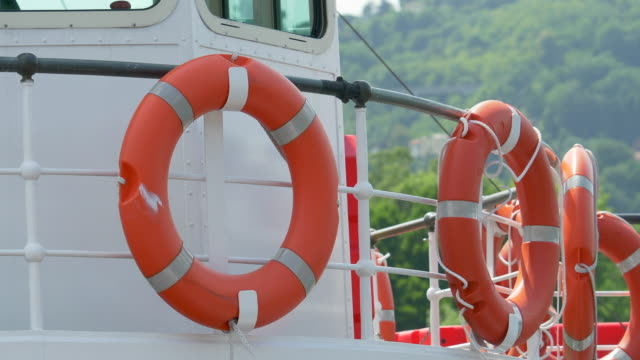 life saver rings on a ferry on lake como, italy, europe. - slow motion - life jacket stock videos & royalty-free footage