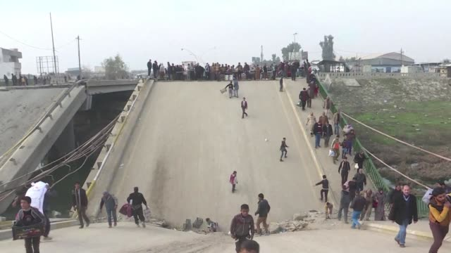 life starts to return to normal for residents in eastern mosul who say it was 'hell' under the islamic state group - after life stock videos & royalty-free footage