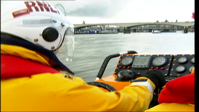 RNLI lifeboat stations on the Thames **Baywatch music over following sequence** London River Thames Crew along on river ENDS