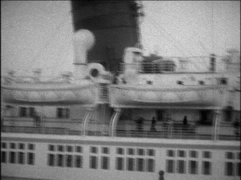 b/w 1929 pan lifeboats of s.s. bermuda ocean liner leaving port / home movie - 1920 1929 video stock e b–roll