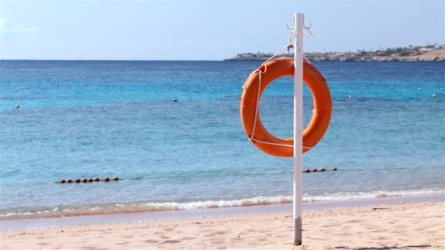 lifebuoy at the beach. - safety stock videos & royalty-free footage