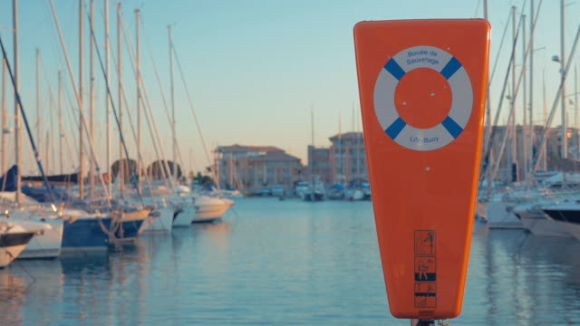 lifebuoy on the harbor bank. - life belt stock videos & royalty-free footage