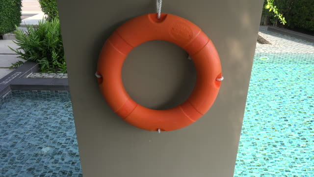 lifebuoy ring on tropical beach - life belt stock videos & royalty-free footage