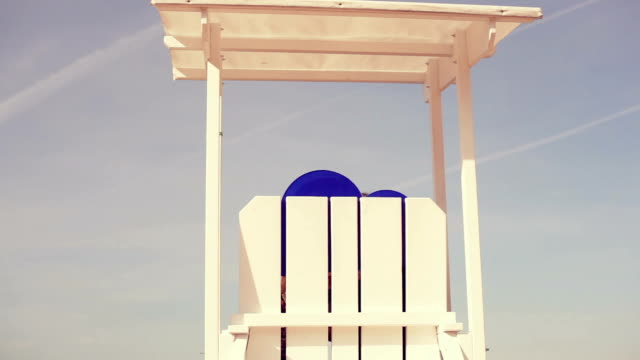 lifeguard chair and funny cloud - lifeguard chair stock videos & royalty-free footage