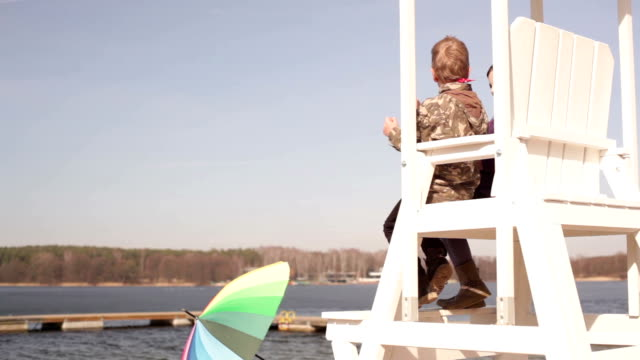 lifeguard chair and kids - lifeguard chair stock videos & royalty-free footage