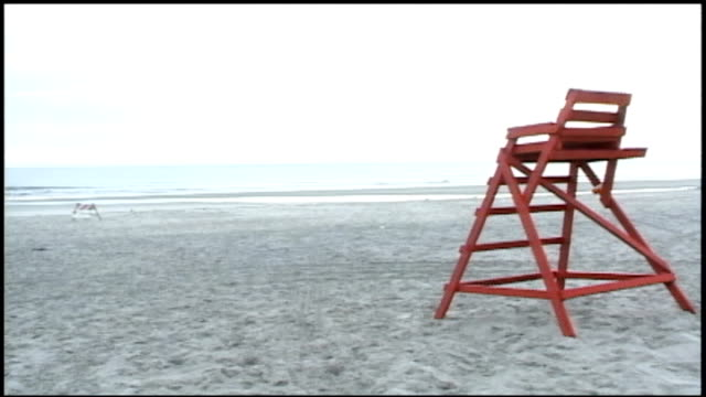 lifeguard chair on beach in jacksonville, florida - lifeguard chair stock videos & royalty-free footage