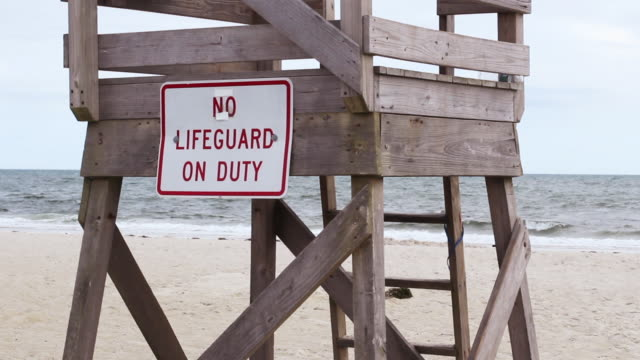 lifeguard chair on beach - lifeguard chair stock videos & royalty-free footage