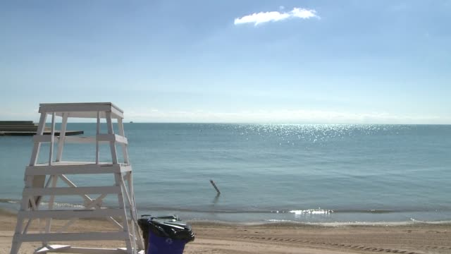 lifeguard chair on july 30, 2013 in chicago, illinois - lifeguard chair stock videos & royalty-free footage