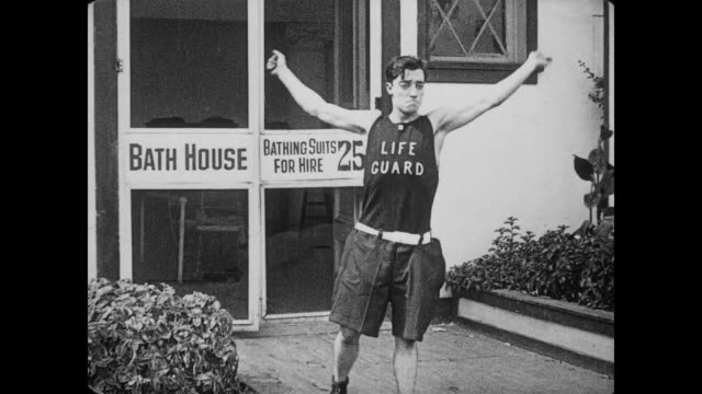 1917 lifeguard (buster keaton) does front flip in front of bathhouse - buster keaton stock videos and b-roll footage