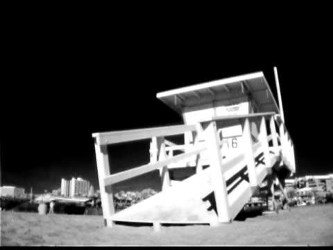lifeguard hut on beach - cabina del guardaspiaggia video stock e b–roll
