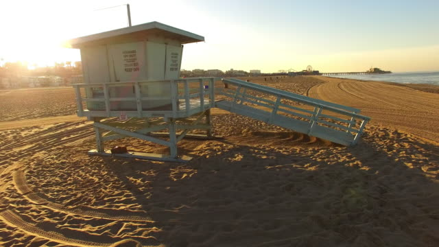 aerial lifeguard hut on the santa monica beach - santa monica stock videos and b-roll footage