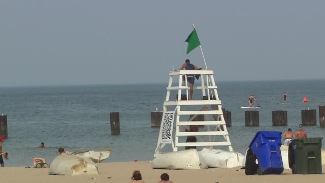 lifeguard in chair on north avenue beach at north avenue beach on august 27, 2013 in chicago, illinois - lifeguard chair stock videos & royalty-free footage